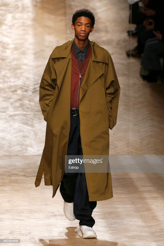 A model walks the runway at the Qasimi show during London Fashion Week Men's January 2018 at 100 Sydney Street on January 6, 2018 in London, England.