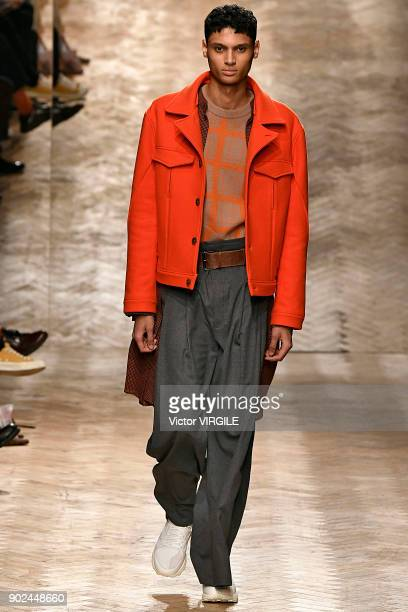 A model walks the runway at the Qasimi show during London Fashion Week Men's January 2018 at 100 Sydney Street on January 6 2018 in London England