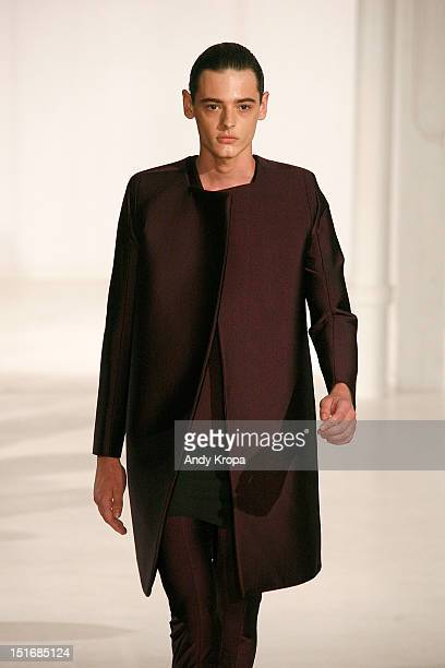 A model walks the runway at the Rad by Rad Hourani Unisex Collection spring 2013 fashion show during MercedesBenz Fashion Week at the Studio 450 on...