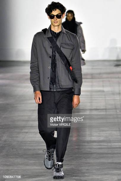 A model walks the runway at the RAEBURN Fall/Winter 2019/2020 fashion show during London Fashion Week Men's January 2019 at the BFC Show Space on...