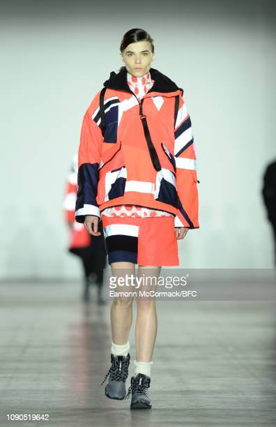 A model walks the runway at the RAEBURN show during London Fashion Week Men's January 2019 at the BFC Show Space on January 06 2019 in London England
