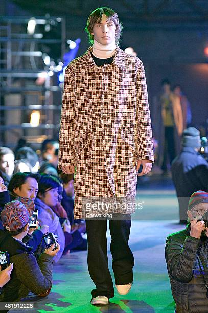 A model walks the runway at the Raf Simons Autumn Winter 2015 fashion show during Paris Menswear Fashion Week on January 21 2015 in Paris France