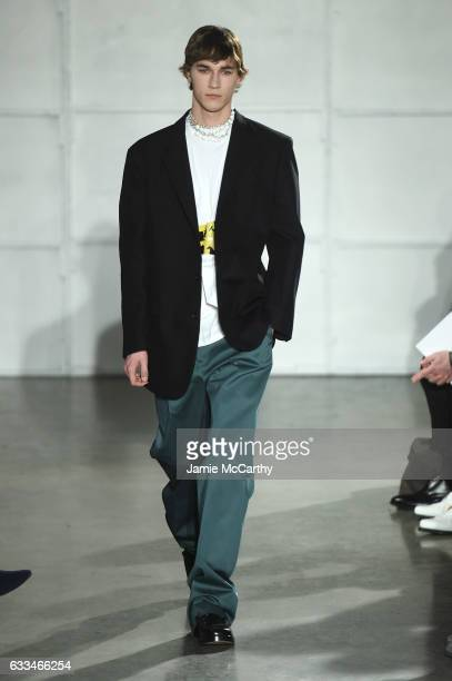 A model walks the runway at the Raf Simons fashion show during NYFW Men'son February 1 2017 in New York City