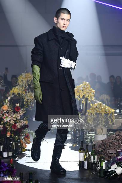 A model walks the runway at the Raf Simons runway show during New York Fashion Week Mens' on February 7 2018 in New York City