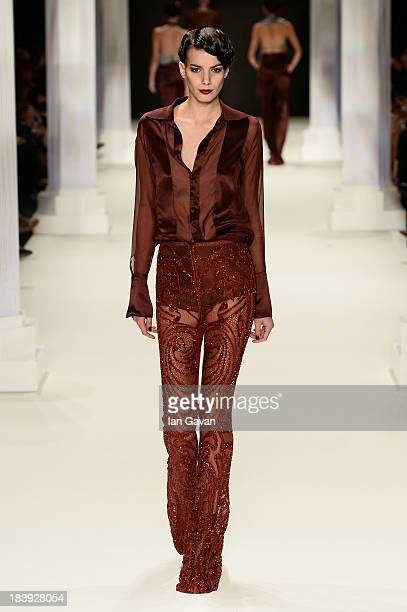 A model walks the runway at the RaisaVanessa Sason show during MercedesBenz Fashion Week Istanbul s/s 2014 Presented By American Express on October...