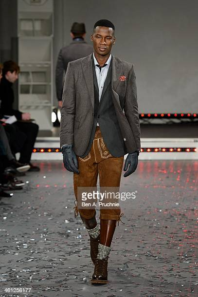 A model walks the runway at the Rake show during The London Collections Men Autumn/Winter 2014 on January 7 2014 in London England
