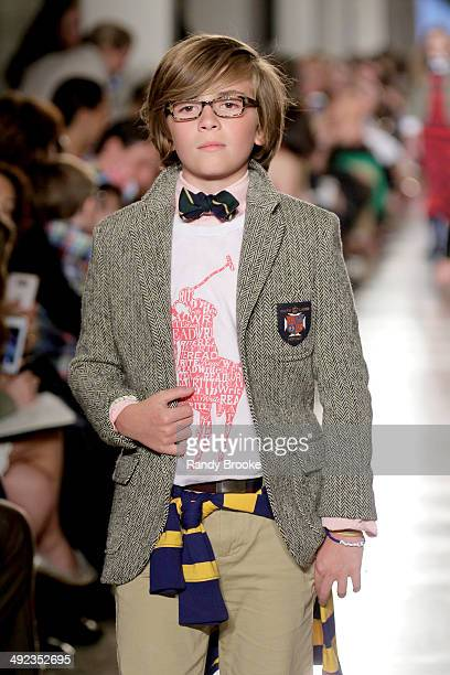 A model walks the runway at the Ralph Lauren Fall 14 Children's Fashion Show in Support of Literacy at New York Public Library on May 19 2014 in New...