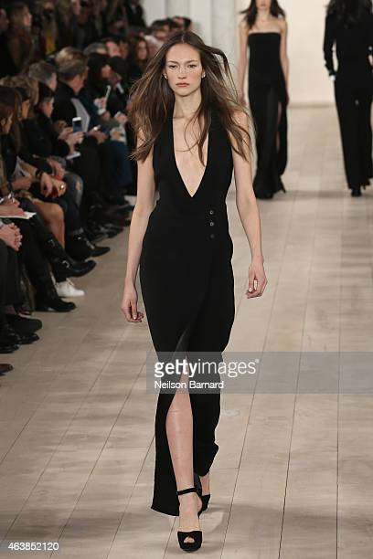 Model walks the runway at the Ralph Lauren fashion show during Mercedes-Benz Fashion Week Fall 2015 at Skylight Clarkson SQ. On February 19, 2015 in...