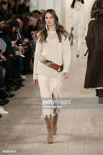 A model walks the runway at the Ralph Lauren fashion show during MercedesBenz Fashion Week Fall 2015 at Skylight Clarkson SQ on February 19 2015 in...
