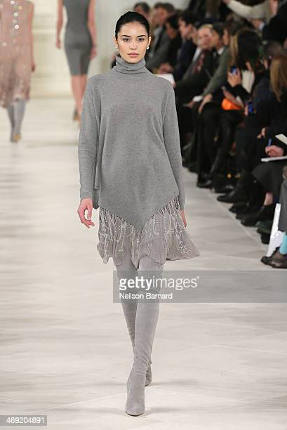 A model walks the runway at the Ralph Lauren fashion show during MercedesBenz Fashion Week Fall 2014 on February 13 2014 in New York City