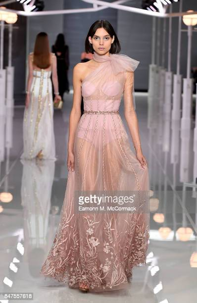 A model walks the runway at the Ralph Russo Spring/Summer 2018 Ready to Wear show at Old Billingsgate on September 15 2017 in London England