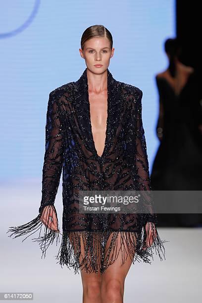 A model walks the runway at the Rasit Bagzibagli show during MercedesBenz Fashion Week Istanbul at Zorlu Center on October 12 2016 in Istanbul Turkey