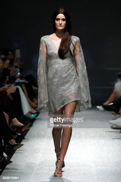 A model walks the runway at the Rasit Bagzibagli show during MercedesBenz Fashion Week Istanbul at Shangri La Hotel Istanbul on March 27 2018 in...