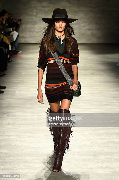Model walks the runway at the Rebecca Minkoff fashion show with TRESemme during Mercedes-Benz Fashion Week Fall 2015 at The Pavilion at Lincoln...