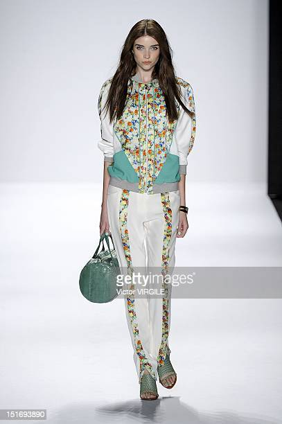 Model walks the runway at the Rebecca Minkoff Spring 2013 fashion show with TRESemme during Mercedes-Benz Fashion Week at The Theatre at Lincoln...