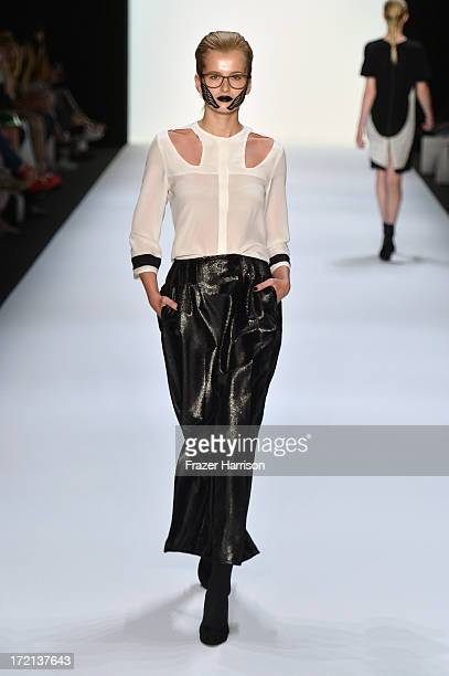 A model walks the runway at the Rebekka Ruetz show during MercedesBenz Fashion Week Spring/Summer 2014 at Brandenburg Gate on July 2 2013 in Berlin...