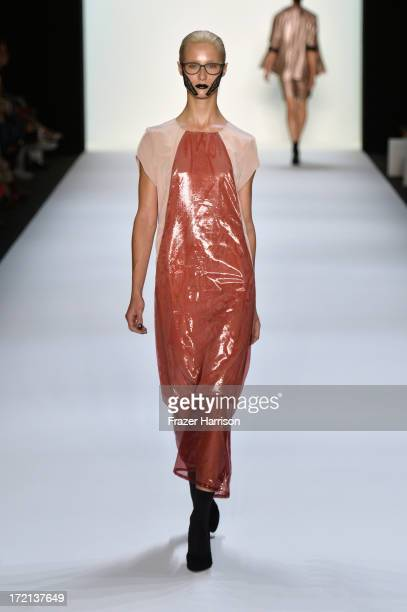 Model walks the runway at the Rebekka Ruetz show during Mercedes-Benz Fashion Week Spring/Summer 2014 at Brandenburg Gate on July 2, 2013 in Berlin,...