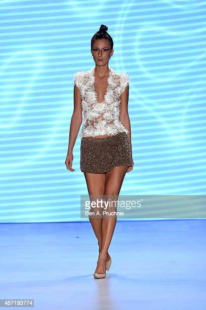 A model walks the runway at the Red Beard By Tanju Babacan show during Mercedes Benz Fashion Week Istanbul SS15 at Antrepo 3 on October 14 2014 in...