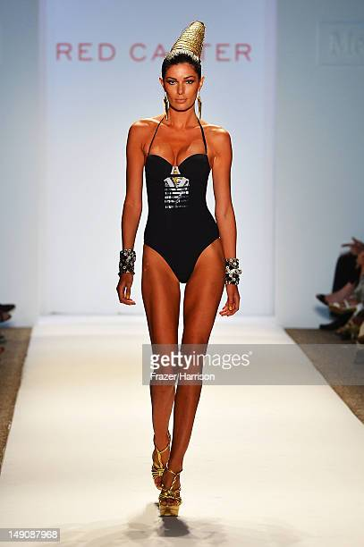 A model walks the runway at the Red Carter show during MercedesBenz Fashion Week Swim 2013 at The Raleigh on July 22 2012 in Miami Beach Florida