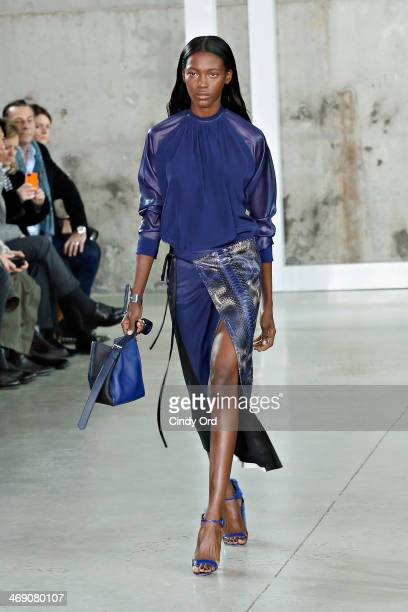 A model walks the runway at the Reed Krakoff fashion show during MercedesBenz Fashion Week Fall 2014 on February 12 2014 in New York City