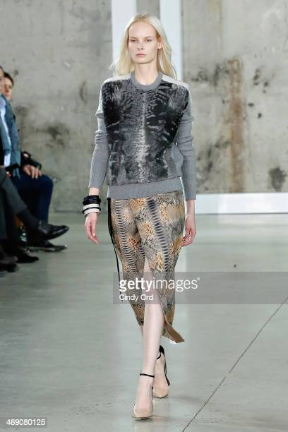Model walks the runway at the Reed Krakoff fashion show during Mercedes-Benz Fashion Week Fall 2014 on February 12, 2014 in New York City.