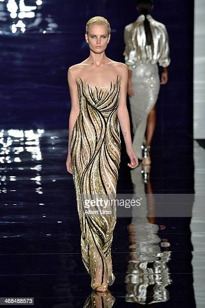 A model walks the runway at the Reem Acra fashion show during MercedesBenz Fashion Week Fall 2014 at The Salon at Lincoln Center on February 10 2014...