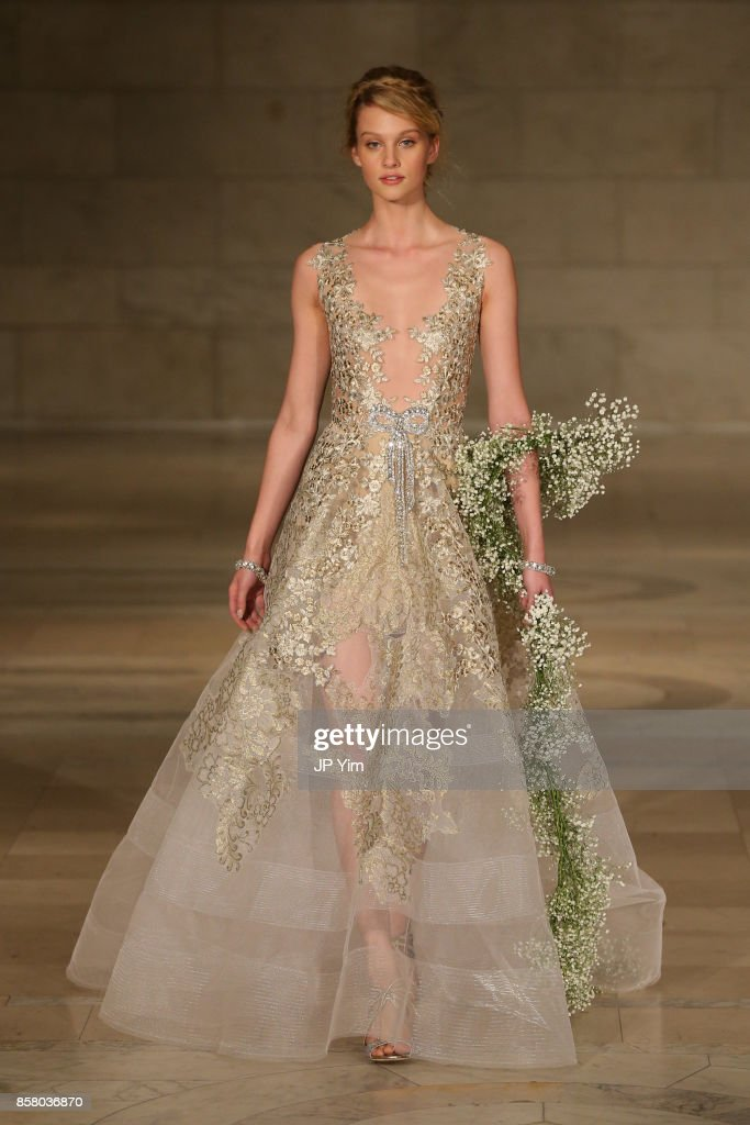 A model walks the runway at the Reem Acra FW 2018 Bridal Show at the New York Public Library on October 5, 2017 in New York City.