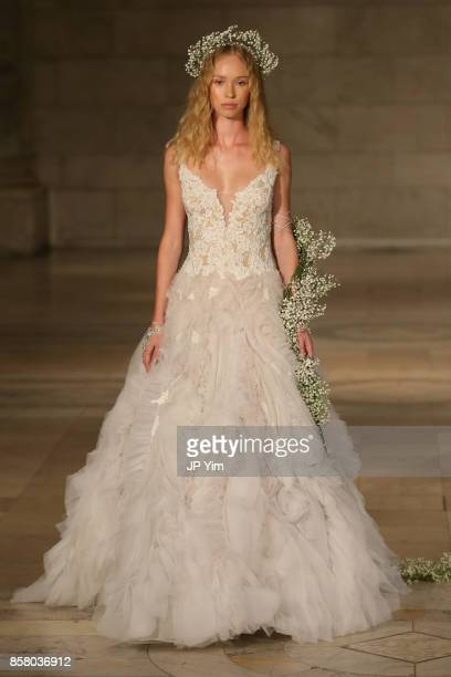 Model walks the runway at the Reem Acra FW 2018 Bridal Show at the New York Public Library on October 5, 2017 in New York City.