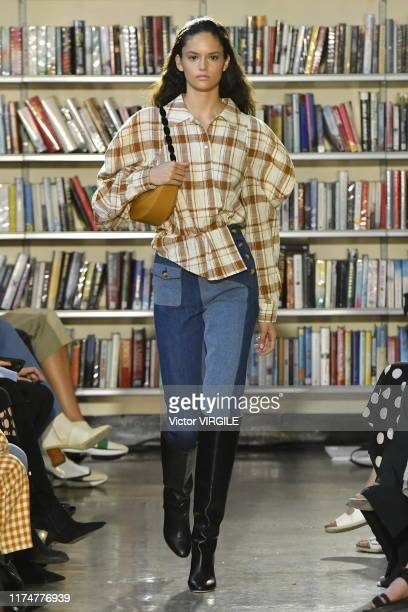 A model walks the runway at the Rejina Pyo Ready to Wear Spring/Summer 2020 fashion show during London Fashion Week September 2019 at Holborn Library...