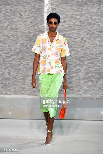 A model walks the runway at the REJINA PYO ** show during London Fashion Week September 2018 at Centre Point on September 17 2018 in London England