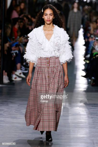 A model walks the runway at the REJINA PYO show during London Fashion Week February 2018 at 6 Burlington Gardens on February 18 2018 in London England
