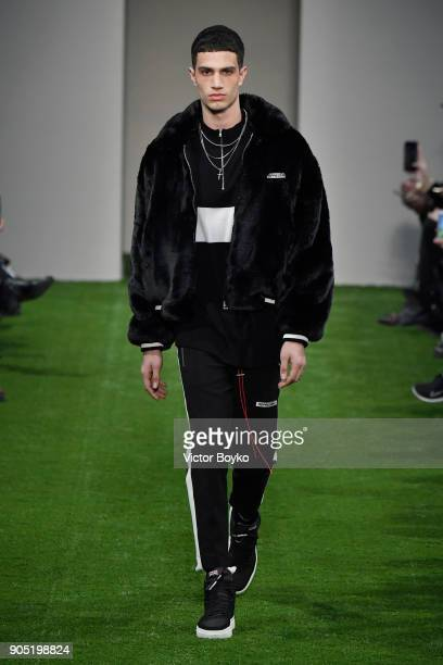 A model walks the runway at the Represent show during Milan Men's Fashion Week Fall/Winter 2018/19 on January 15 2018 in Milan Italy
