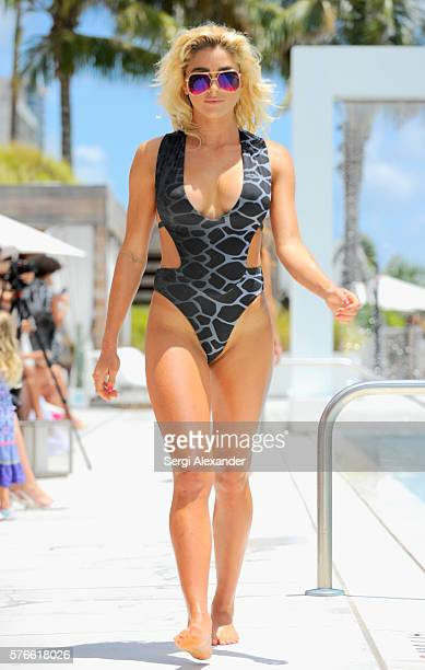 A model walks the runway at the Revel Rey 2017 Collection at SwimMiami Runway at W South Beach on July 16 2016 in Miami Beach Florida