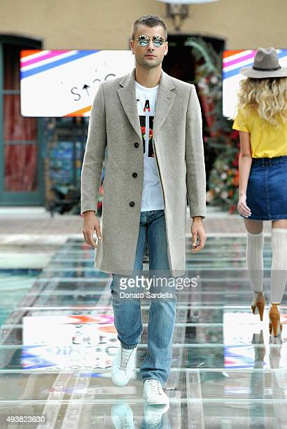 Model walks the runway at the REVOLVE fashion show benefiting Stand Up To Cancer on October 22 2015 in Los Angeles California