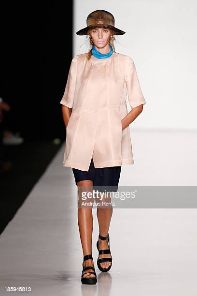 A model walks the runway at the RIA KEBURIA show during MercedesBenz Fashion Week Russia S/S 2014on October 26 2013 in Moscow Russia