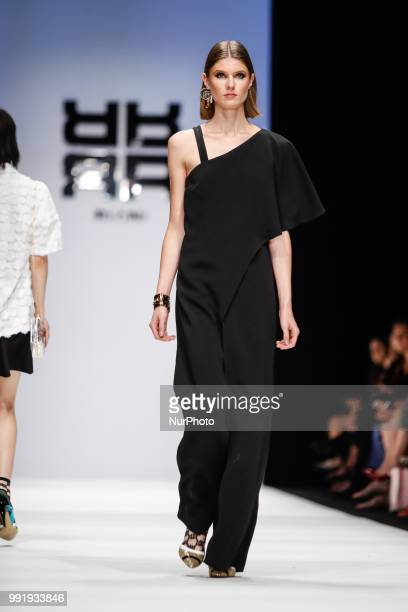 A model walks the runway at the Riani show during the Berlin Fashion Week Spring/Summer 2019 at ewerk on July 4 2018 in Berlin Germany
