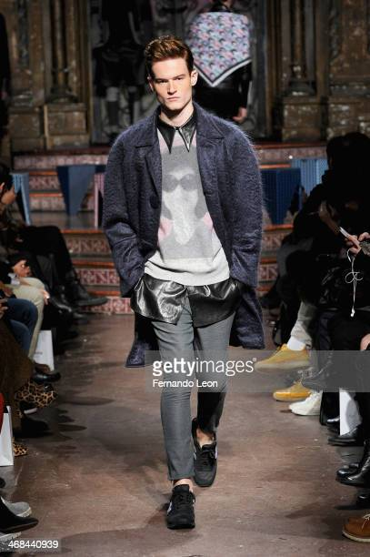 Model walks the runway at the Ricardo Seco fashion show during Mercedes-Benz Fashion Week Fall 2014 at The Angel Orensanz Foundation on February 10,...