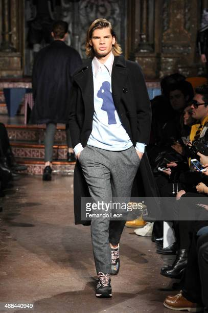 A model walks the runway at the Ricardo Seco fashion show during MercedesBenz Fashion Week Fall 2014 at The Angel Orensanz Foundation on February 10...
