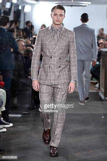 A model walks the runway at the Richard James Autumn Winter 2016 fashion show during London Menswear Fashion Week on January 10 2016 in London United...