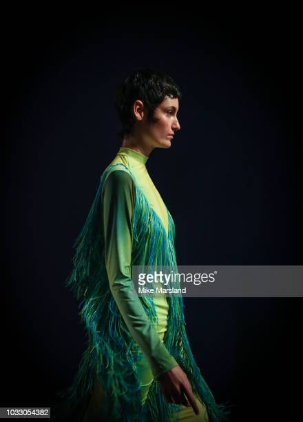 Model walks the runway at the Richard Malone show during London Fashion Week September 2018 at The BFC Show Space on September 14, 2018 in London,...