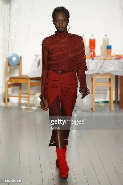 A model walks the runway at the Richard Malone show during London Fashion Week February 2019 at the BFC Show Space on February 18 2019 in London...