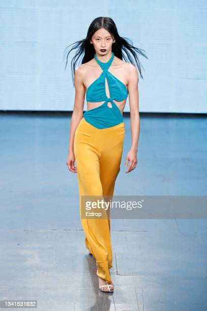 Model walks the runway at the Richard Malone show during London Fashion Week September 2021 at TikTok Space on September 20, 2021 in London, England.