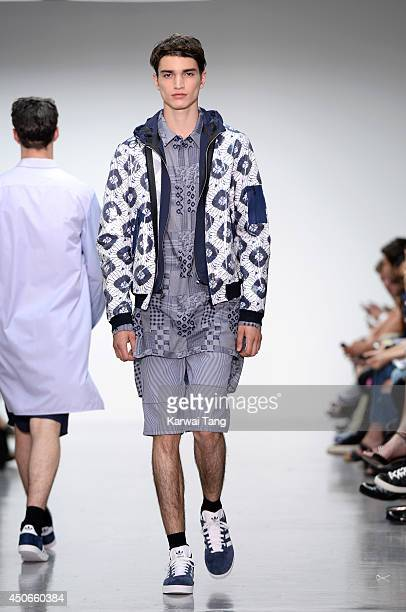 A model walks the runway at the Richard Nicoll show during the London Collections Men SS15 on June 15 2014 in London England