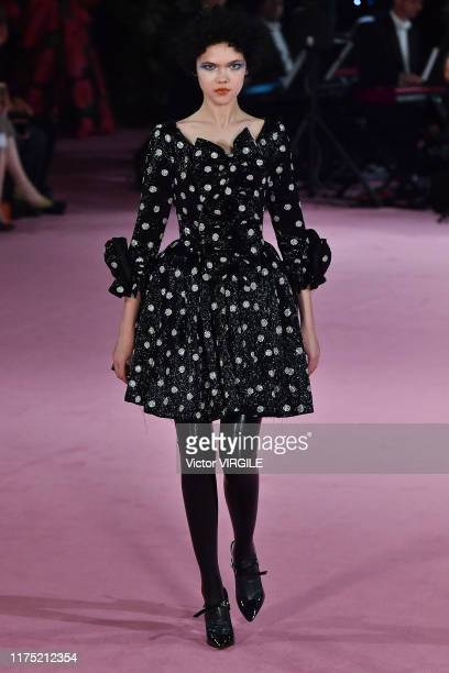 A model walks the runway at the Richard Quinn Ready to Wear Spring/Summer 2020 fashion show during London Fashion Week September 2019 on September 16...