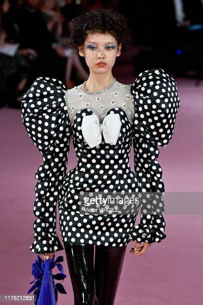 Model walks the runway at the Richard Quinn Ready to Wear Spring/Summer 2020 fashion show during London Fashion Week September 2019 on September 16,...