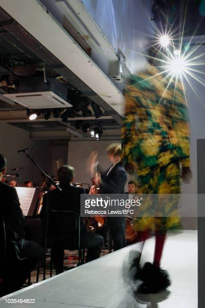 Model walks the runway at the Richard Quinn show during London Fashion Week September 2018 on September 18, 2018 in London, England.