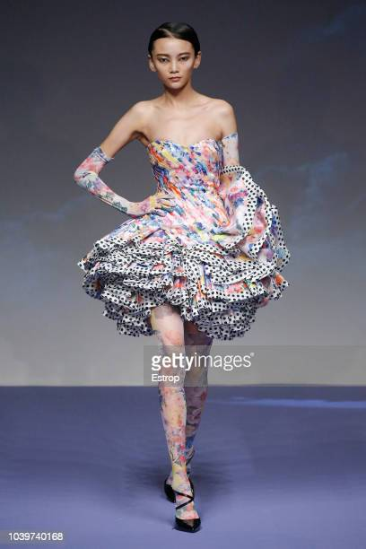 A model walks the runway at the Richard Quinn show during London Fashion Week September 2018 on September 18 2018 in London England