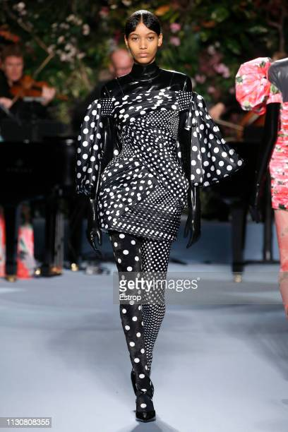 Model walks the runway at the Richard Quinn show during London Fashion Week February 2019 at Ambika P3 on February 19, 2019 in London, England.