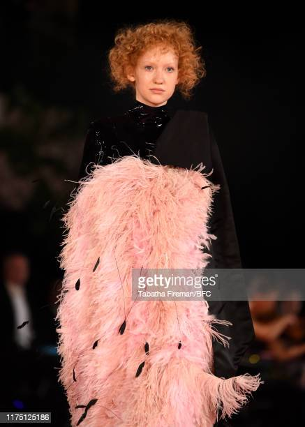 Model walks the runway at the Richard Quinn show during London Fashion Week September 2019 at York Hall on September 16, 2019 in London, England.