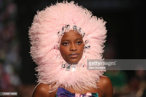 Model walks the runway at the Richard Quinn show during London Fashion Week February 2020 on February 15, 2020 in London, England.